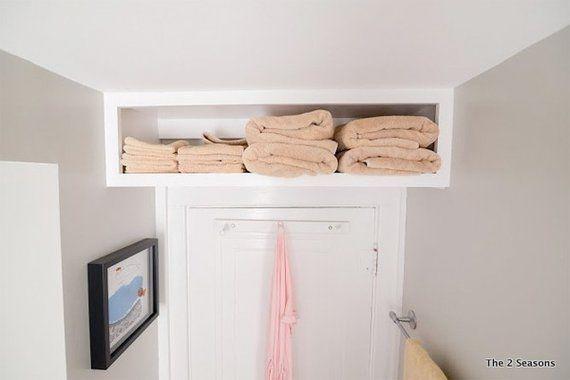 Shelf for Towels Above a Bathroom Door | Storage Solutions