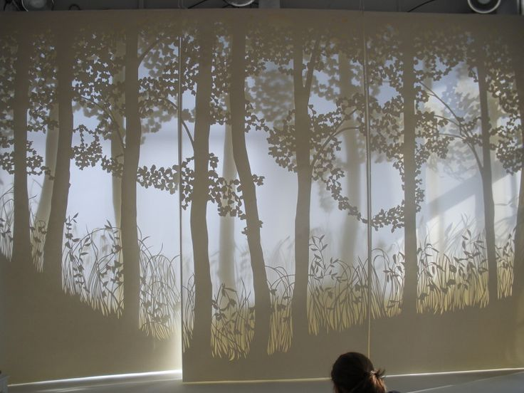 thepapercutter | Window treatments/Store displays made from translucent paper.