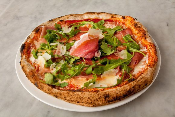 Michael's Pizzeria's Parma prosciutto and arugula pizza, with tomato and house-made mozzarella. The pies at the pizzeria are nominally in th...