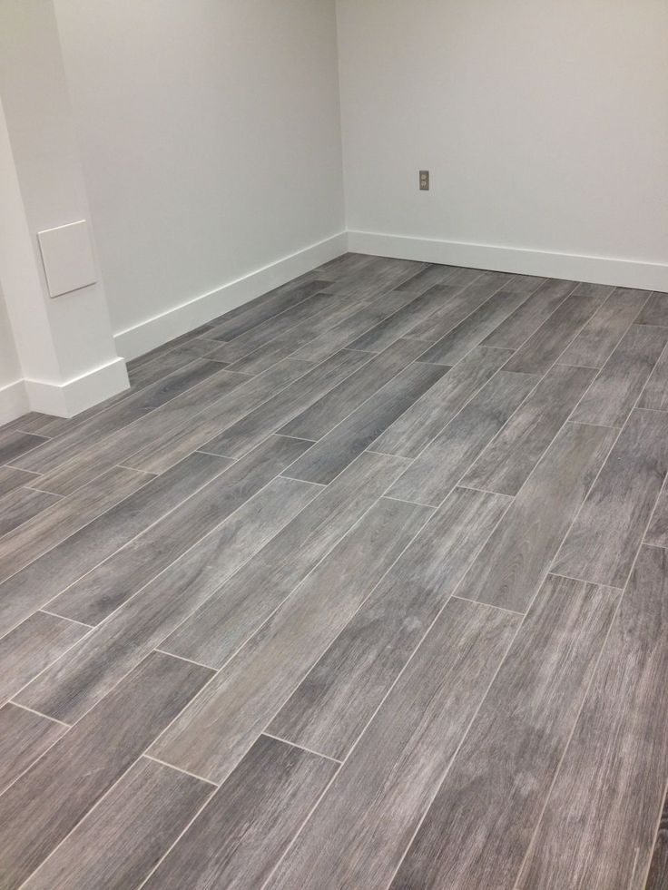 Our porcelain tile, Lux Wood, installed on this room floor. ...