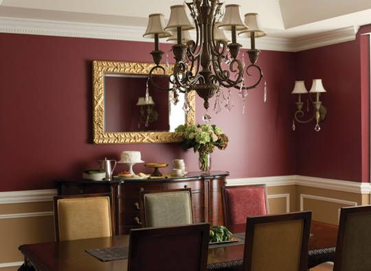 Raisin Torte, from Benjamin Moore, the color is authoritative without being overbearing. Painting the wainscot in Jackson Tan with White Dove accents further lightens the mood of the dining