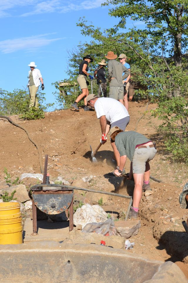 Our volunteers working on to protect the local farmer's water pipes from any elephant damage.