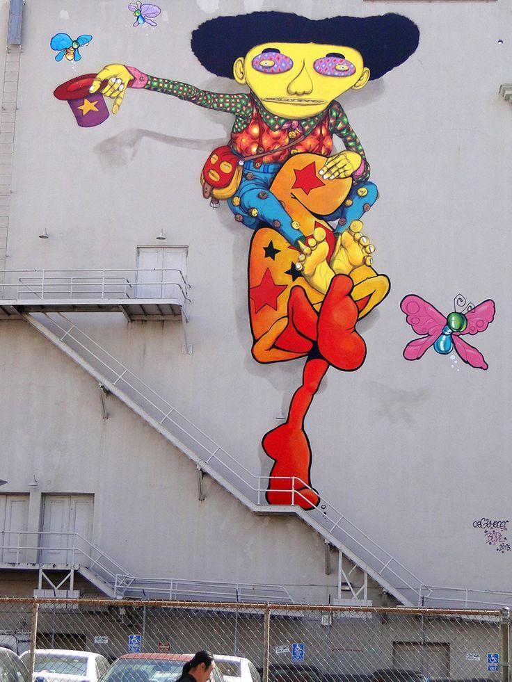 Location: Taylor @ Market Street in San Francisco, Ca Artist: Os Gemeos (Brazilian) Mark Bode. , Catching Butterflys. | Street Art SF  #poppingupdoc #popsurrealism #pop #popart #streetart #Graffiti #artederua #graffiti #art #artwork #contemporaryart #modernart #realcreativeart #watercolor #urbanart #cores #colores #colors #sprayart #intervention #urbanintervention #graffitiwall #kunst #photooftheday #street #graffitiart #lowbrow #lowbrowart