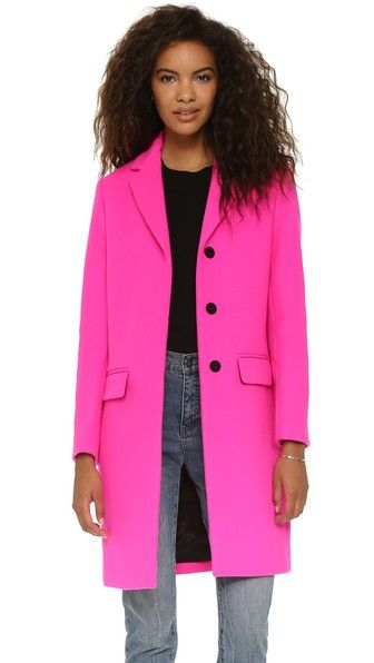 This long MSGM pink wool coat has a vivid neon hue, giving classic tailoring a cheerful twist.   MSGM Wool Coat