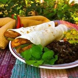 Fajitas at home! Chicken briefly steeps in a zesty marinade before a saute with onions and peppers in this faithful rendition of a Mexican favorite. Serve with warm flour tortillas, salsa and sour cream to complete the picture.