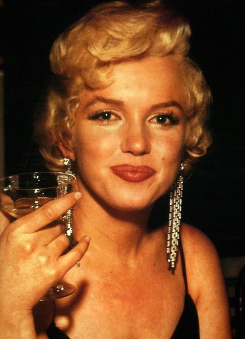 alwaysmarilynmonroe: A rare colour photo of Marilyn photographed at the premiere for The Rose Tattoo, December 1955.