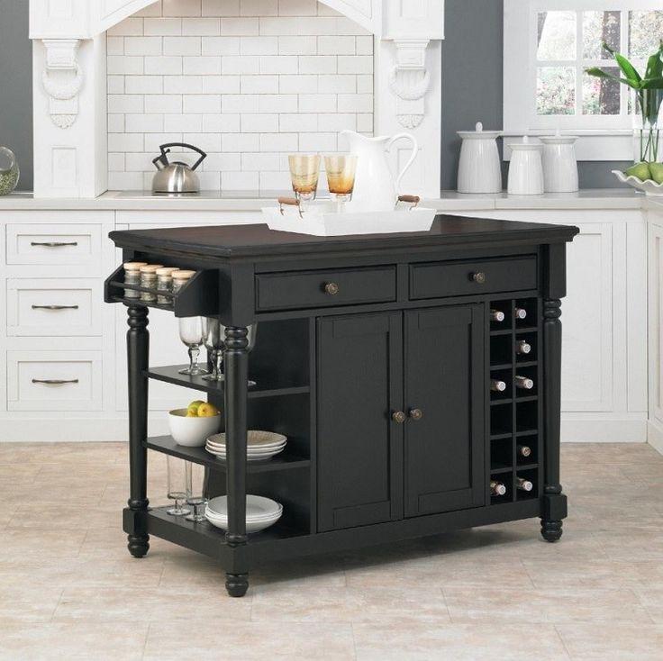 petite cuisine blanche avec îlot central en bois peint noir avec rangement