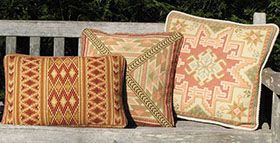 three color coordinated Kilim pillows in the cross-point TM kit collection