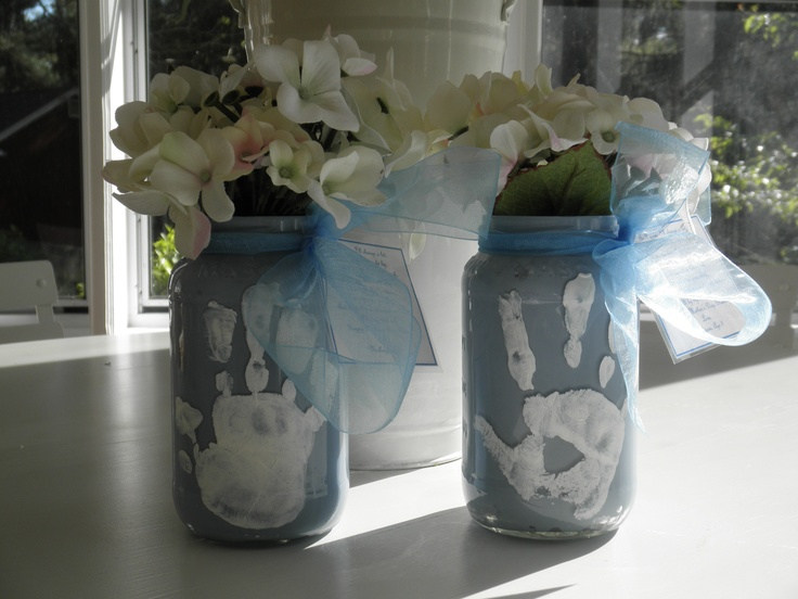 Made this with the kids as a gift for Nana for Mother's Day, and it came out so cute!  We used enamel paint, swirled it on the inside of clean Mason jars with a foam brush, then put their handprints on the outside in white enamel paint.  Baked it as directed on the paint bottle to make it waterproof, then attached a little poem, a pretty ribbon and faux hydrangeas, but she'll be able to use these with fresh flowers too.  Hope she likes it!