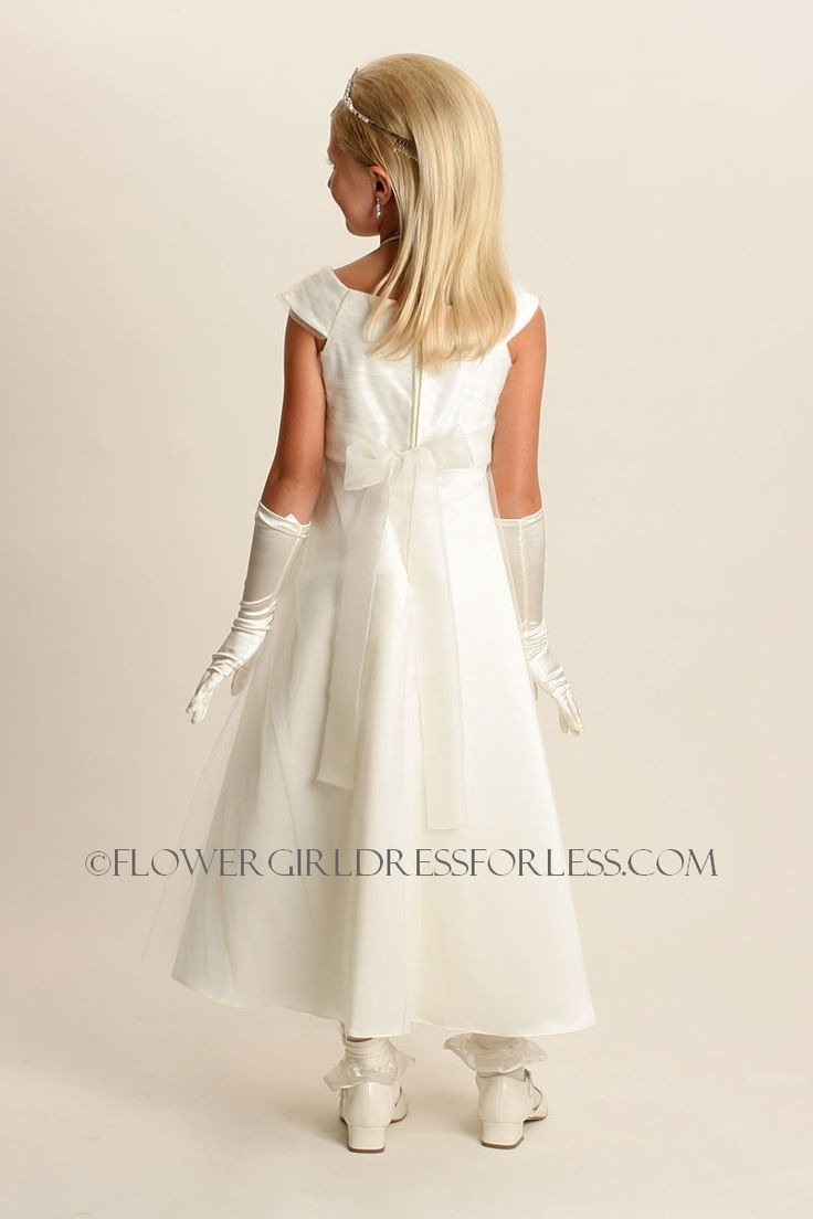 I like this better once I saw the back. I did not notice that it tied in back and the size is best for them. No Champagne accent. Very elegant. DP_2703I - Flower Girl Dress Style 2703- Choice of Ivory or White Aline with Appliques - All First Communion Dresses - Flower Girl Dress For Less
