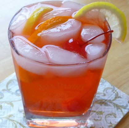 An old-fashioned whiskey cocktail. This is the way we like ours - fruity with a dash of bitters, soda, and plenty of rocks! Be sure to use a good bourbon. Bottoms up! Enjoy! From eHow. History (taken from about.com): The Old-fashioned is a classic whiskey cocktail that has been served since around 1880 at the Pendennis Club in Louisville, Kentucky and is (disputedly) the first drink referred to as a cocktail. It is the perfect ideal of what a cocktail should contain: a spirit, a sweet, a…