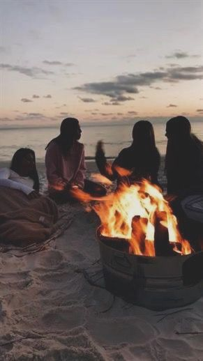 Bonfire on the beach at sunset. great idea for birthday or spring/summer party f…