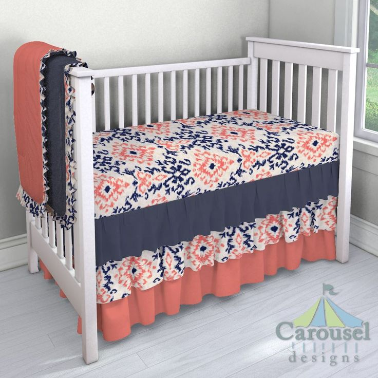 Crib bedding in Navy and Coral Ikat Damask, Solid Navy, Solid Coral. Created using the Nursery Designer® by Carousel Designs where you mix and match from hundreds of fabrics to create your own unique baby bedding. #carouseldesigns