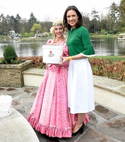 Princess Viktoria of Bourbon-Parma donned a pair of wellington boots, wore white calf-length skirt with an unusual bottle green top with pleated flute sleeves and simple gold jewelry, as she collected money from the bottom of a wishing well in Efteling Park, an amusement park in Kaatsheuvel in the Netherlands. The money benefited Save The Children, of which Princess Viktoria is patron.