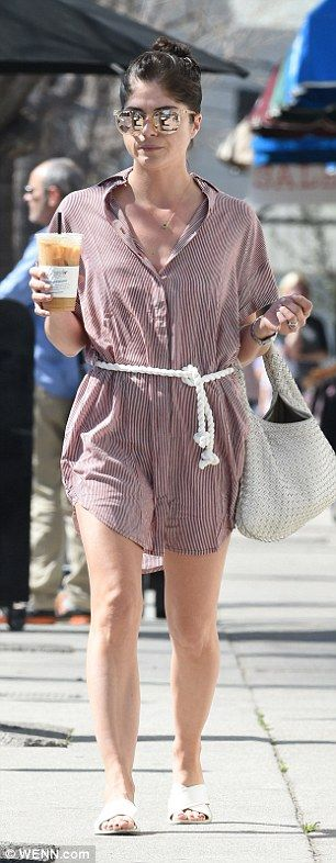 All tied up!The 44-year-old actress showed off her slender legs in a striped red shirt dr...