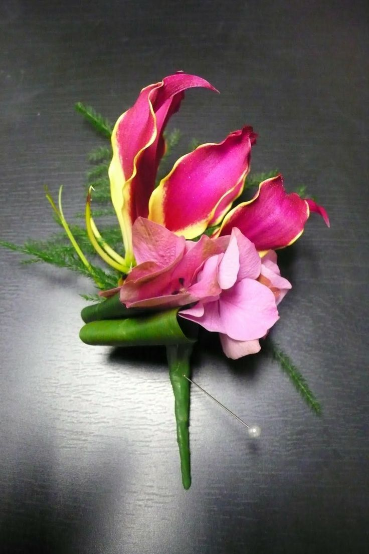 Gloriosa Lily Wedding Bouquet | Rich had a buttonhole of Gloriosa with a small detail of hydrangea to ...