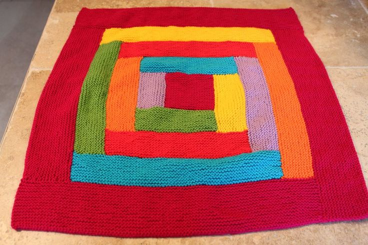 Hand knitted log cabin baby pram blanket