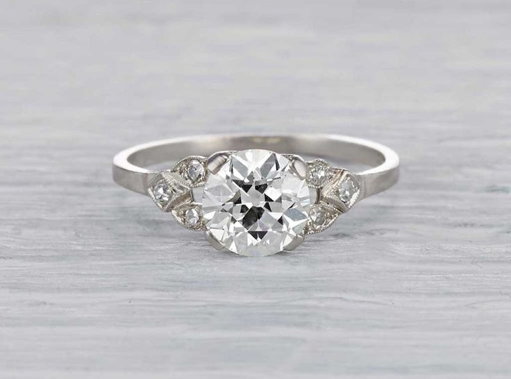 Antique early Art Deco engagement ring made in platinum and centered with an EGL certified approximately 1.30 carat old European cut diamond with I-J color and VS2 clarity. Accented with single cut diamonds. Circa 1930.