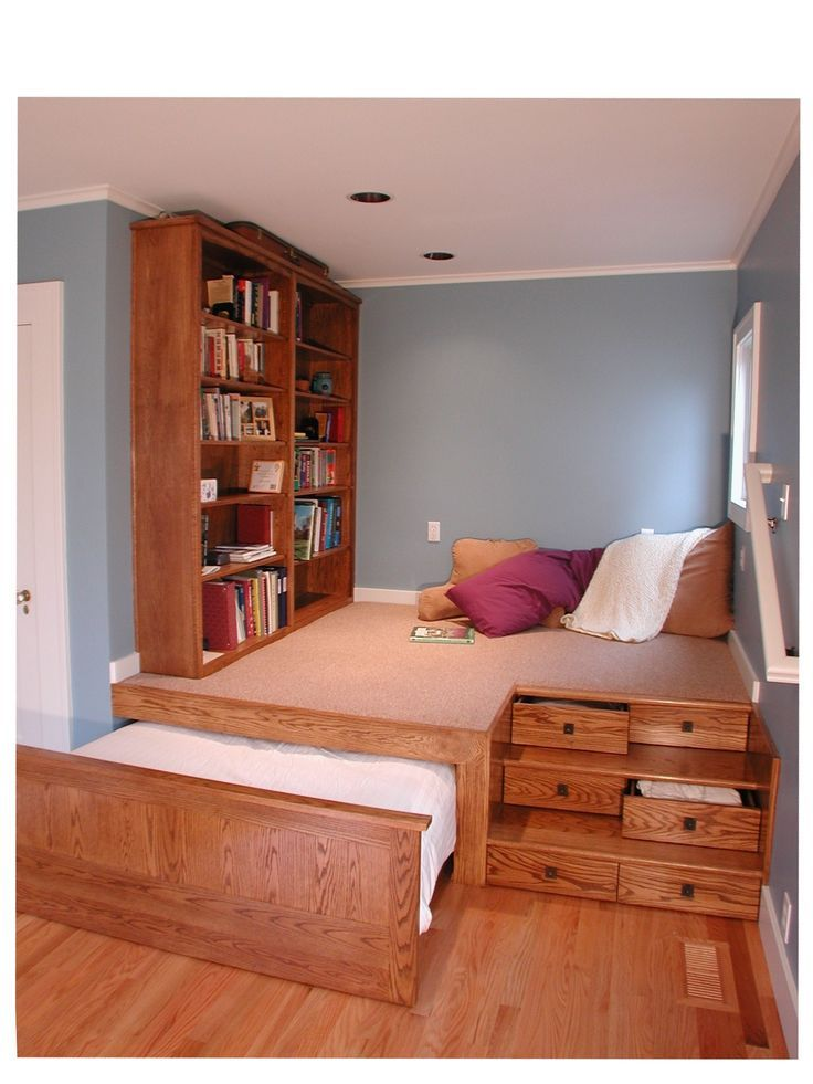 Nook built into larger room Multilevel platform, pullout trundle bed, storage drawers.