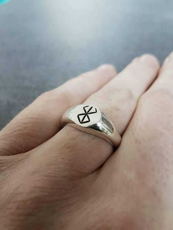Silver ring with engraved berserk brand of sacrifice mark. The ring has a maximal height of 9.4 millimeter and a minimal height of 4.2 millimeter. Ring sizes are available in size 17-19 millimeter (inside diameter). *(Available in more sizes soon) The ring is made of recycled sterling
