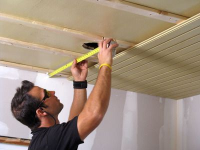 How to Install a Tongue-and-Groove Plank Ceiling - DIY Network (We did this in our sunroom. But since we were covering a damaged ceiling, we skipped the furring strips step and glued the planks directly to the ceiling with a couple of finishing nails from a staple gun to hold them up until the glue dried. This really sped up the process and we knocked the whole thing out in a day. Then we primed/painted and installed trim. It's holding up well and looks great!)