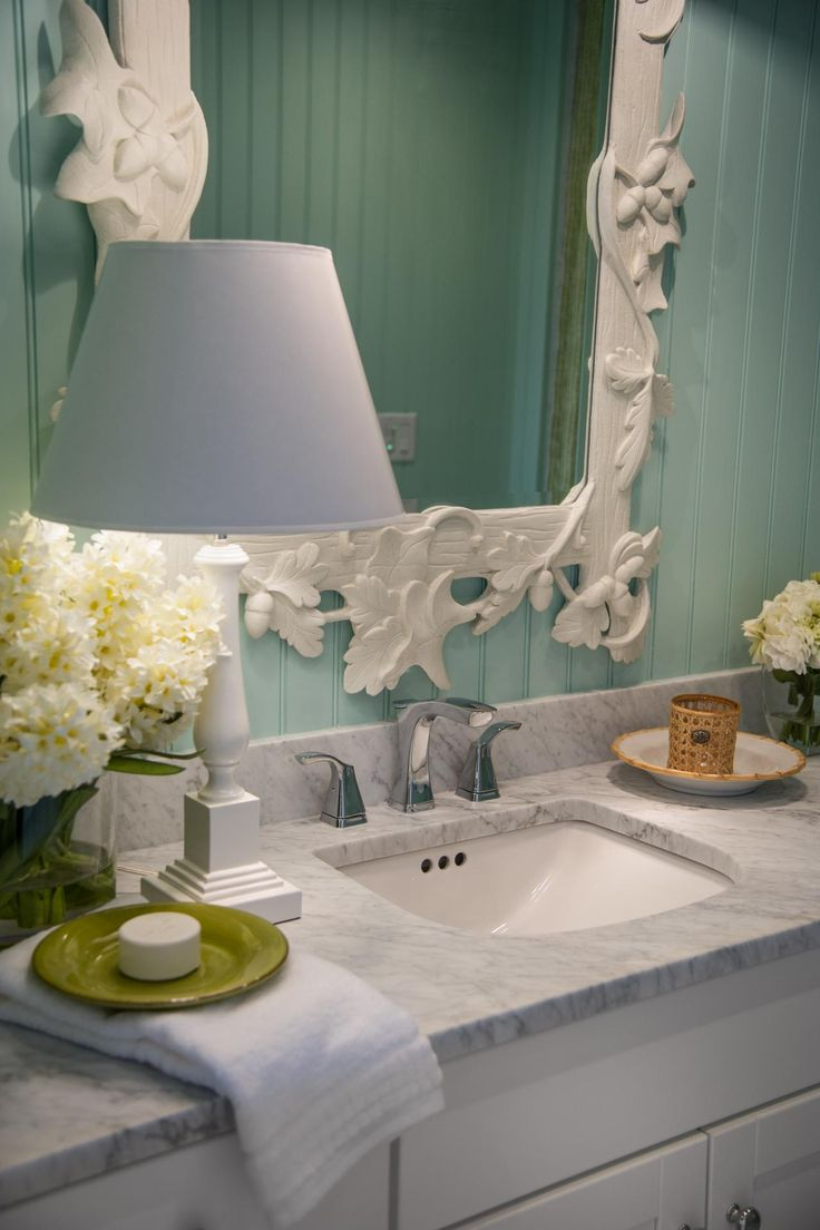 Photographic Gallery A white table lamp rests on the marble countertop for a classic finish in the HGTV Dream Home kids u bathroom