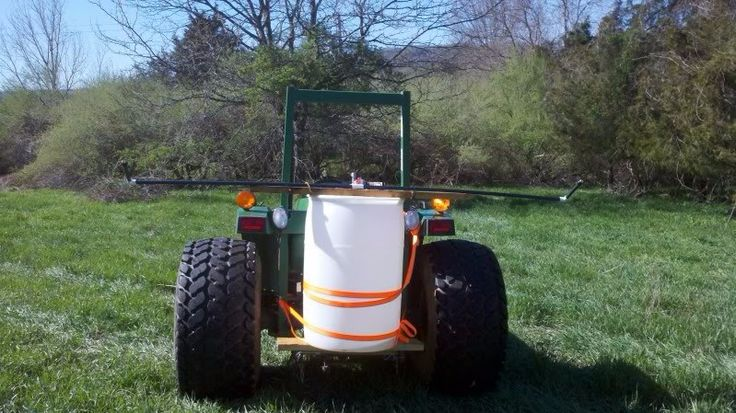 Sprayer by mikmaze -- Homemade sprayer constructed from a 3 gpm pump, lawn sprinkler pipe and spray heads, and a 55-gallon drum. www.homemadetools...