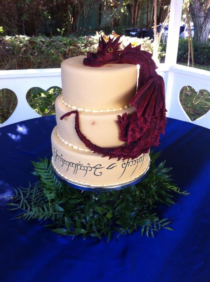 Lord of the rings wedding cake with elvish script and a giant Smaug the dragon! -repinned from LA celebrant https://OfficiantGuy.com