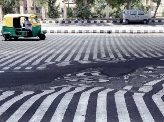 india, heat wave, heatwave, climate change, deaths from heat stroke, melting streets, melting asphalt, india heat 2015