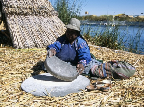 The grinding of corn to make mielie-meal is a very important food preparation technique in South Africa. The traditional way (displayed in the photo) would be to finely grind up corn by hand with two large stones. The alternate, and much more commonly used way is to use a corn mill, which grinds the corn for you!