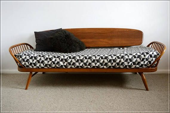 Description ---------------------------------------- Original Ercol day bed.  Original condition, brand new Pirelli webbing, brand new high density seat foam.  Please note !:  - cushions not included  - as you can see on photos it was used with bedspread (NOT INCLUDED!) - you can buy