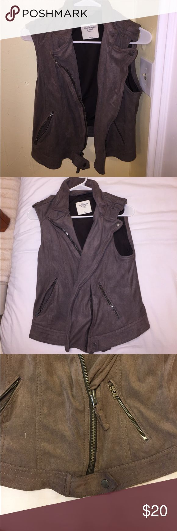 Abercrombie and Fitch suede vest Super comfy, very good condition. Worn once: can dress it down or up. Suede material with an off center zip up. Abercrombie & Fitch Jackets & Coats Vests