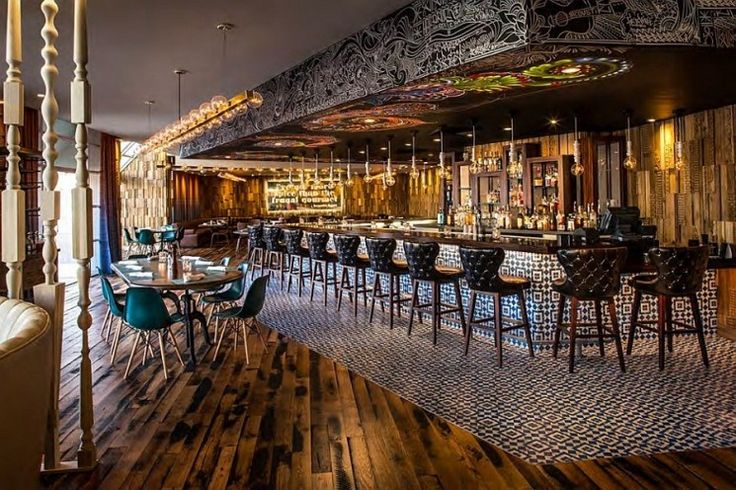 architecturerestaurant bar design with pallet wooden flooring feat ethnic pattern rug area and oval wooden dinning table complete with large bulb