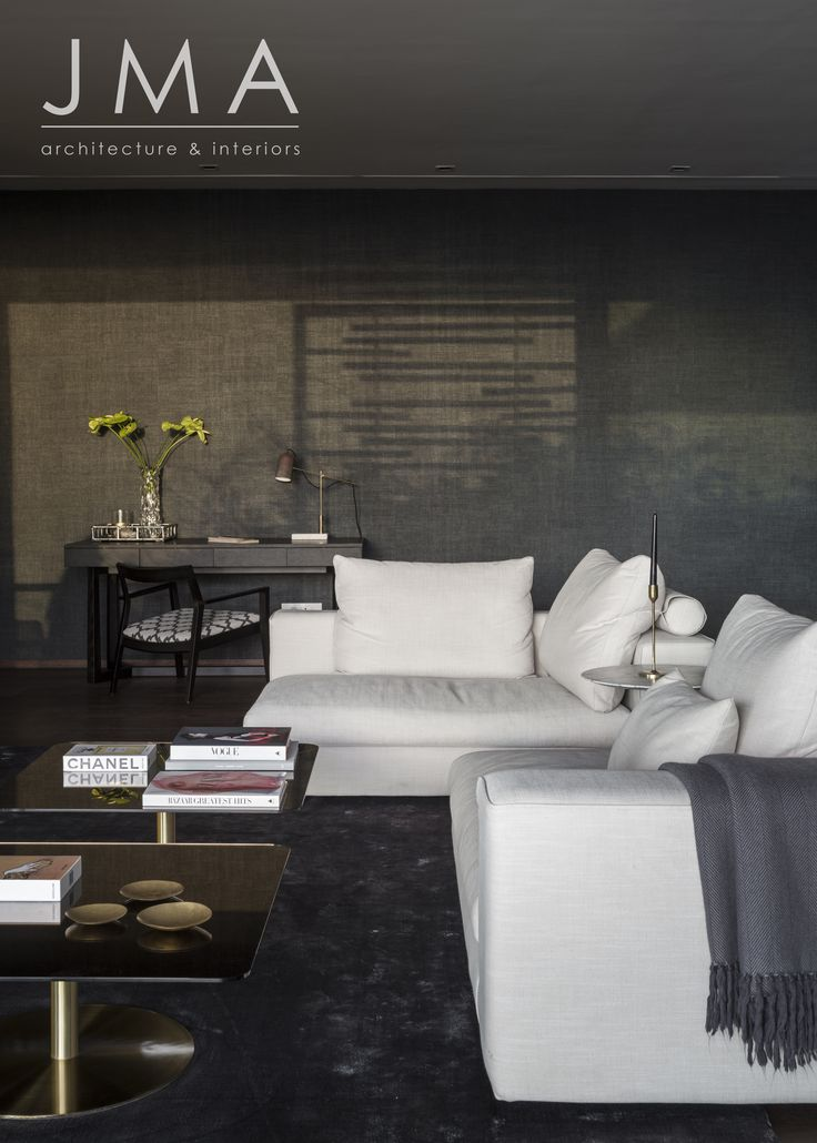 White and grey lounge interior, featuring a textured wallpaper.