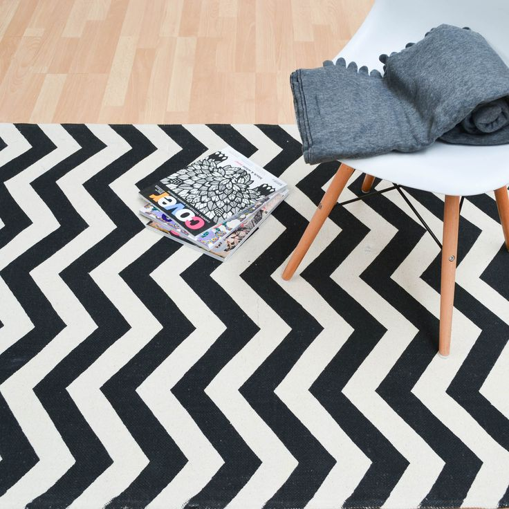Onix ZigZag Rugs in Mono feature a bold ivory and black zigzag design that will…