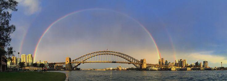 A rainbow is seen over the Sydney Harbour Bridge