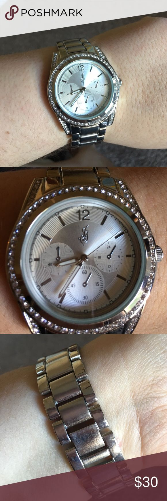 Beautiful silver large face watch. Has a easy detachable link. 3 small hands do not work they are fake. Watch itself works great. Got an Apple Watch so getting rid of all my old watches Jaclyn Smith Accessories Watches