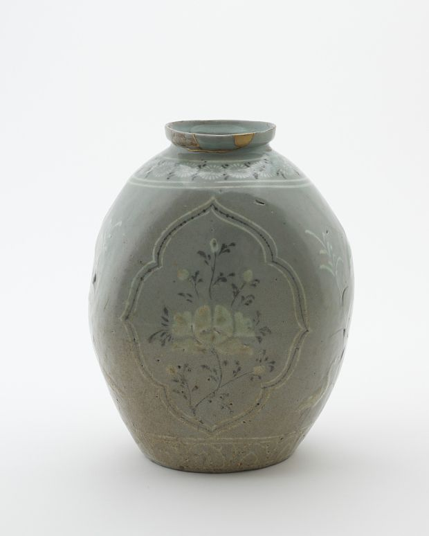 Goryeo period, late 13th-early 14th century Korea, Jeolla-do province, Gangjin or Buan county, Gangjin or Buan kilns Stoneware with white and black inlays under celadon glaze; gold lacquer repair 25.4 x 20.2 x 17.8 cm Gift of Charles Lang Freer Freer Gallery of Art