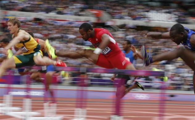Jeff Porter (C) of the U.S., South Africa's Lehann Fourie (L) and Barbados' Greggmar Swift compete in their men's 110m hurdles round 1 heat at the London 2012 Olympic Games at the Olympic Stadium August 7, 2012.