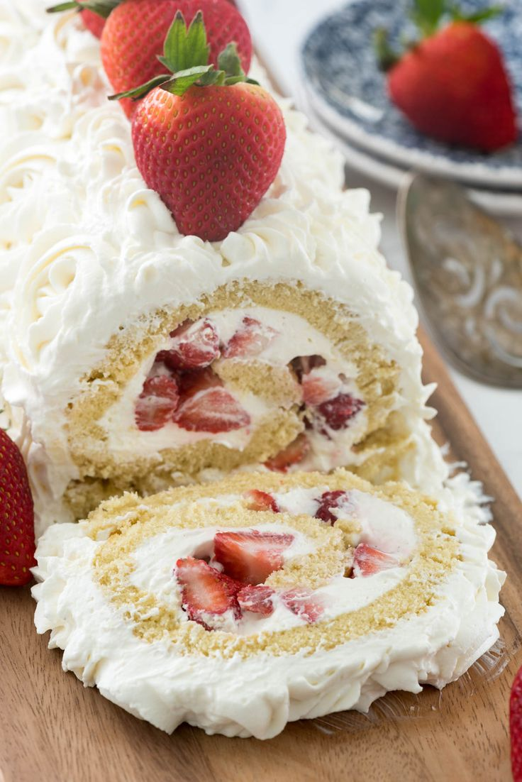 Strawberry Shortcake Cake Roll - this easy cake roll recipe is filled with fresh strawberries and cream cheese whipped cream! The perfect cake!