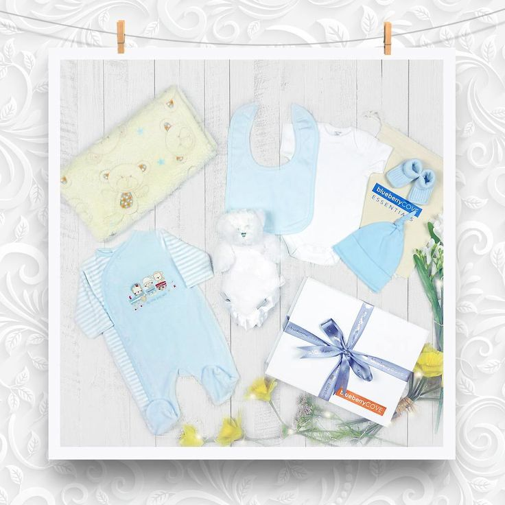 ac6c362fca59 Baby boy gift. A luxury white gift box tied with ribbon filled with a sky