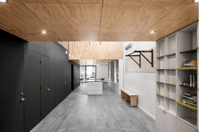 ply ceiling black walls concrete floors gym skylight ceiling pods