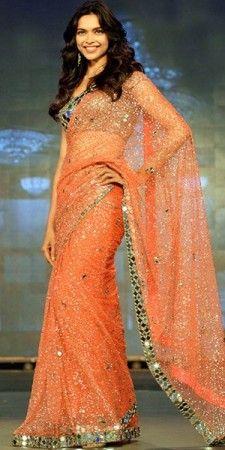 CELEBRITY: Deepika Padukone BLOUSE FABRIC: Dhupian FABRIC: Net, Banarasi, Satin WORK: Mirror, Multi COLOUR: Black, Pink OCCASION: Party, Festival
