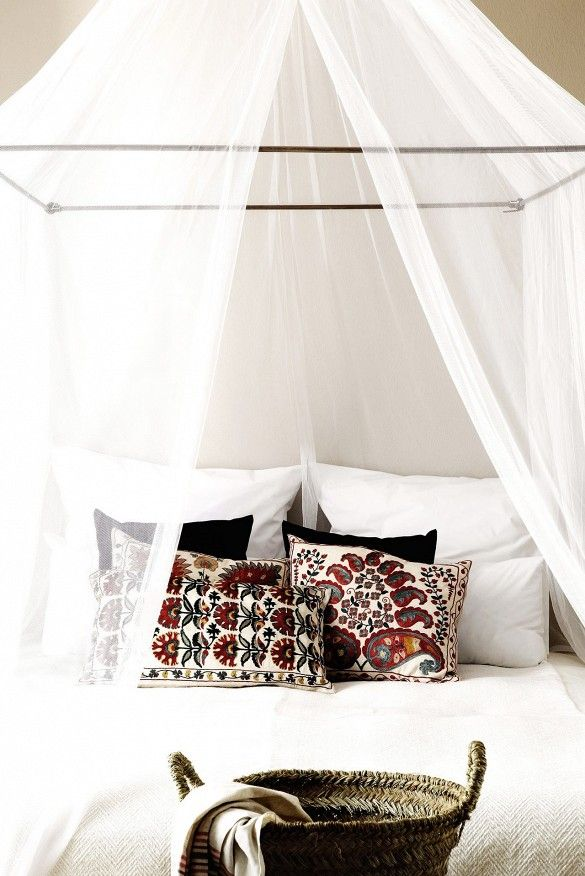 10 Hacks for Creating a Canopy Bed via @domainehome // Mosquito net over bed in Mykonos hotel.