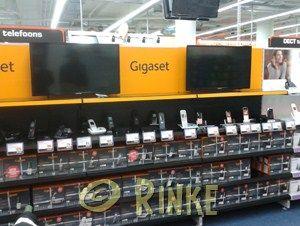Gigaset Mediamarkt. Winkelschappen op div locaties voorzien van branding style