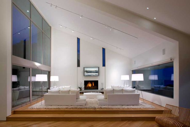 Architecture, Elegant Modern Private House Including Living Room With White Sofa And Cushions Added On Wooden Floor And White Rug Completed With Glass Wall And Fireplace: Private House Designs with Splendid and Luxurious Contemporary Themes