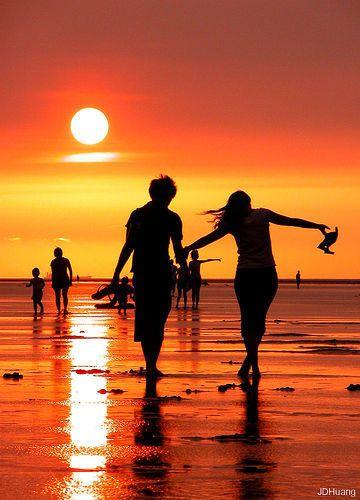 silhouettes on the beach at dusk...