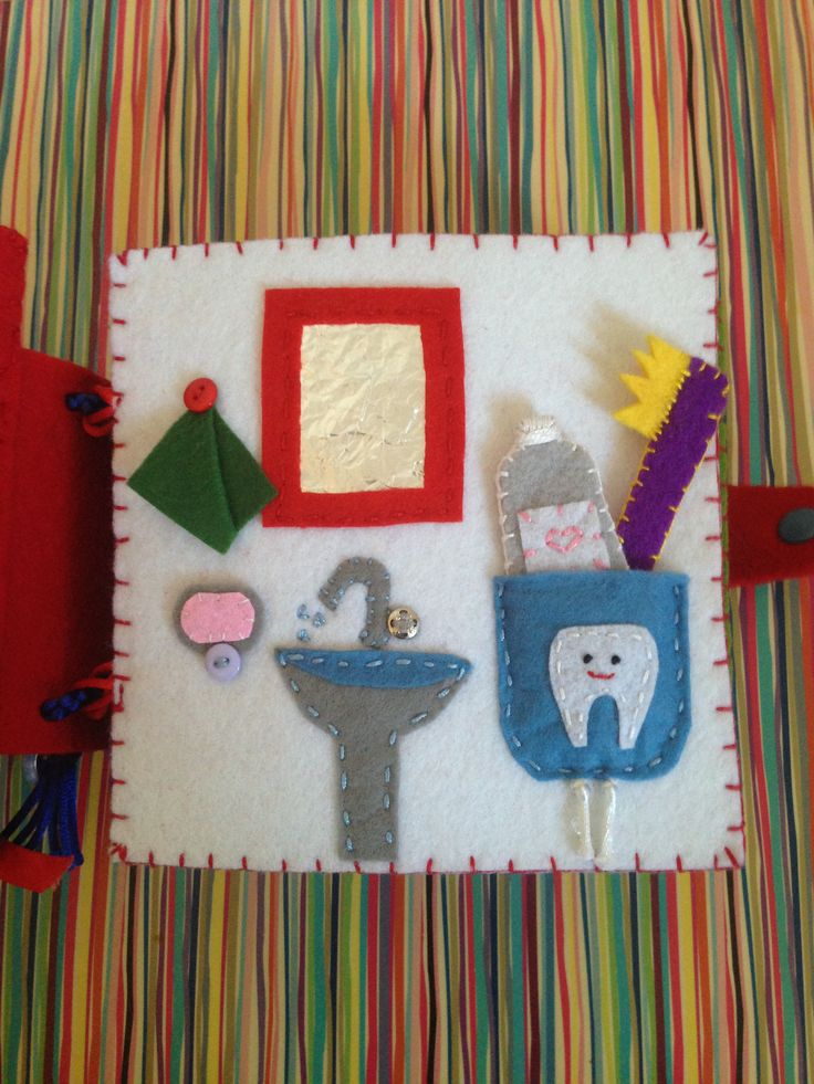 Felt Quiet Books - Brush Your Teeth Page - I used aluminum foil for the mirror and cover with a piece of vinyl - It is possible to pull the toothpaste and toothbrush - One of my favorite pages that I made for Mila's quiet book :)