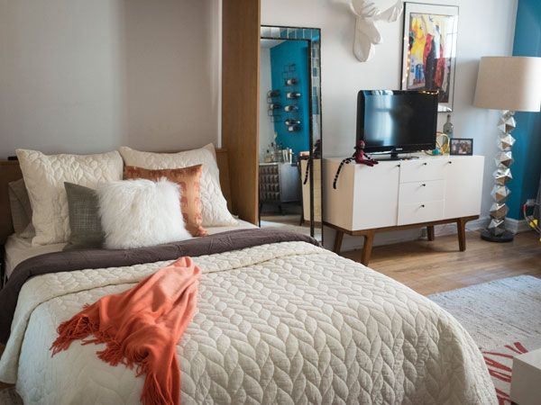 Cecily Strong's Apartment Makeover featuring Dumont Credenza + Braided Quilt + Shams from west elm