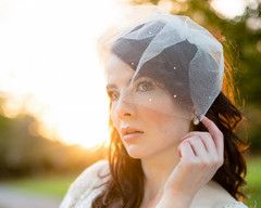 This is a beautiful tulle birdcage veil adorned with a sprinkling of tiny crystals.  Impeccable for a wedding or special occasion, this piece is set onto a 3inch/7.5cm silver tone comb which is completely hidden beneath the veil. €98/£81/$135.